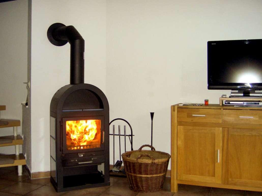 Wohnzimmer mit Kamin Ferienwohnung Malve 3